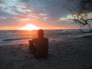 Man watching the sunset on the beach in Mal Pais-2
